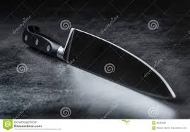 knife kitchen knife lying on an modern concrete cutting board knife kitchen knife lying on an modern concrete cutting board stock photo