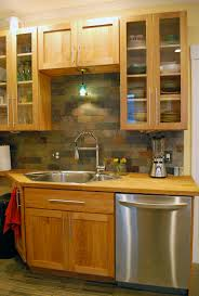 Slate Tile Backsplash Pictures And by Red Birch Cabinets With A Slate Tile Backsplash Nice And Earthy