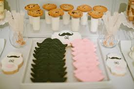 fun gender reveal party with a mustaches and lips theme the