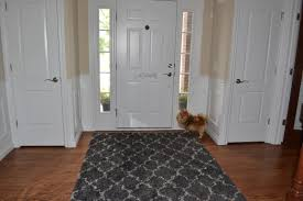 Cheap Area Rugs For Living Room Flooring Dark Grey 5x7 Area Rugs On Wooden Floor Before The White