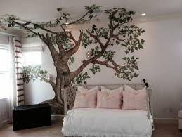 nursery with a painted tree and lighted bird houses tree has