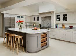 harvey jones shaker kitchen with curved cupboards painted in