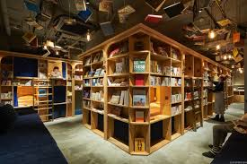 sleep in a bookshelf at the new bookstore themed hostel in kyoto