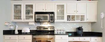 paint vs stain kitchen cabinets compare 2021 average painting vs staining cabinets costs