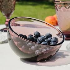 an unusual amethyst glass dessert bowl featuring a contemporary