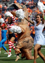 cheerleader halloween costumes broncos cheerleader dresses up like giant dinosaur and nails