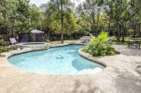 Backyard Swimming Pools by Upacale Backyard Swimming Pool That Is Surrounded By Treesplants