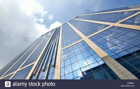 office building with plate glass walls and gleaming steel