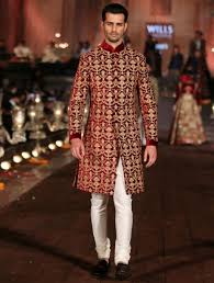indian wedding dress for groom maroon sherwani with heavy zari work looks indeed regal sherwani