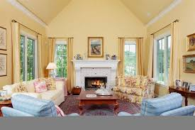 traditional living room with hardwood floors high ceiling in