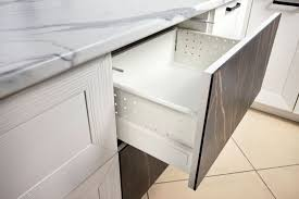 kitchen cupboard with drawers how does one adjust soft closing cabinet drawers