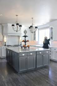 granite countertops gray and white kitchen cabinets lighting