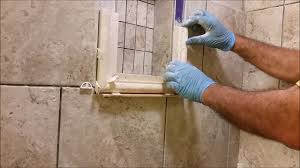 how to install a shower niche frame using traventine chair rail