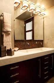 beautiful classic bathroom design with above mirror lamp