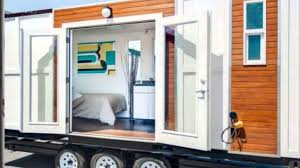 man converts shipping container into tiny home on wheels youtube