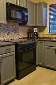 White Kitchen Cabinets With Black Appliances by Cabinets U0026 Drawer Wood Countertop And Stainless Steel Appliances