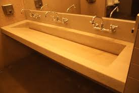 sloping white porcelain trough sink two faucets combined tiny hand