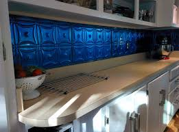 made a kitchen back splash with powder coated tin ceiling tiles