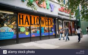 the window of a party city store in new york informs shoppers of