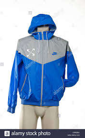nike windbreaker men u0027s nike windrunner jacket in blue grey with pinwheel logo and