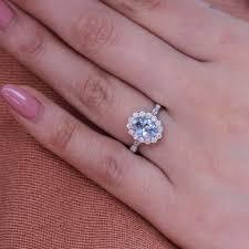 aquamarine and diamond ring scalloped halo ring w oval aquamarine and diamond la more design
