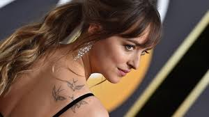 dakota johnson pubic hair dakota johnson butt tattoo necessitated fifty shades body double