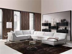 modern living room design like the silverish couch and red curtains hint of texture