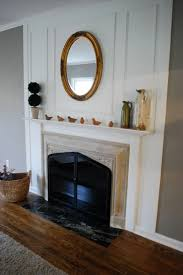 oval mirror above fireplace home design ideas
