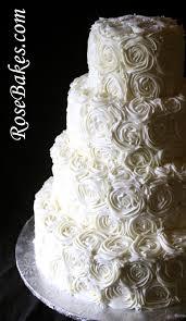 wedding cake roses ivory buttercream roses wedding cake with lovebirds cake topper