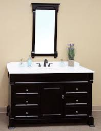 frameless picture hanging plain white countertop exposed grey stone wall square frameless
