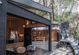 forest house a cluster of interconnected cabins in the hills of