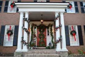Christmas Decorations For Your Front Porch by Front Porch Decorated For Christmas With Three Wreaths On Door And