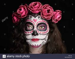 nice makeup for halloween of skull on woman face stock photo