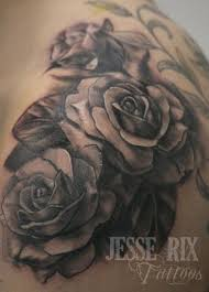 large rose tat on side an elegant black and white rose tattoo
