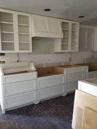drawers or cabinets in kitchen lots of lower cabinet drawers simple shaker styling range hood