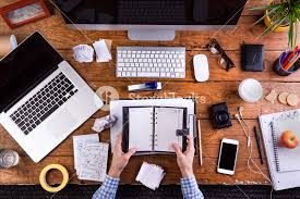 Business Computer Desk Business Person At Office Desk Holding A Personal Organizer Smart