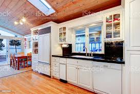 white kitchen cabinets with wood interior white kitchen cabinets with black counter tops in luxury house stock photo image now