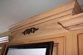 how to install crown molding on staggered kitchen cabinets