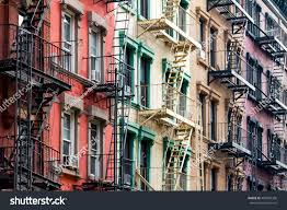nyc block rainbow colored apartment buildings stock photo
