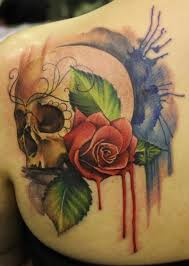 watercolor skull and red rose tattoo on shoulder blabe tattoos book