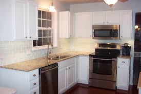 Kitchen Tile Laminate Flooring White L Shaped Cabinetry With Granite Countertop With Grey Subway
