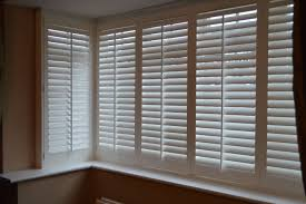 bow window wooden blinds dors and windows decoration window shutters gallery bespoke wooden shutters acorn window blinds for bay windows