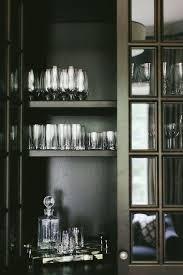 glass doors white criss cross bar cabinet