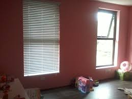 interior design pink wall with awning window and bali blinds for