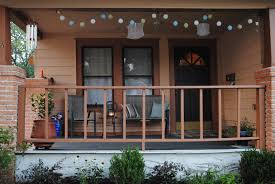 interesting front porch with colorful hanging ball lights combined
