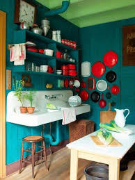 kitchen turquoise dark walls with red accents and white wall