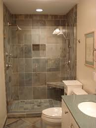 gray natural stone shower wall tile shower head faucet bath seat