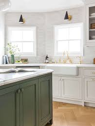 green kitchen cabinets with white island bored of white kitchens discover the cabinet color trending