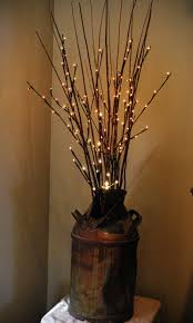 lighted willow branches lighted willow branches in my own antique milk can i also spray