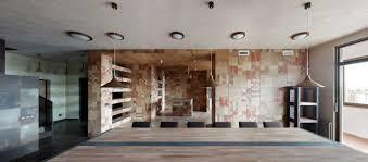 warm multilevel apartment interior involving open kitchen along